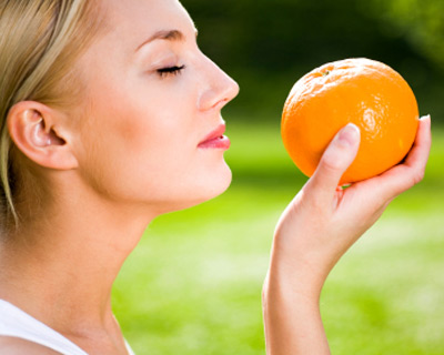 photogallery-fake-awake-woman-smelling-orange